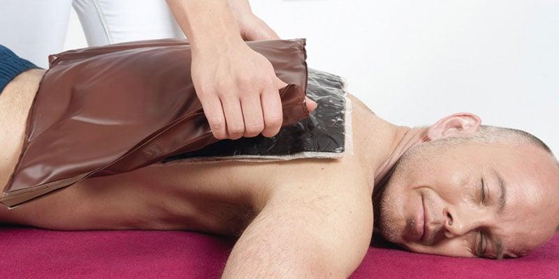 Auch Wärmeträger gehören zur Ausstattung einer Massagepraxis